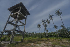 Observation tower with palm trees over blue sky with clouds Stock Photos