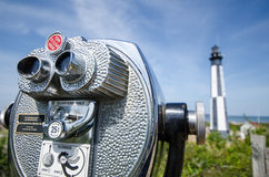 Observation viewfinder looking at Cape Henry Lightouse. An observation viewfinder coin-operated binoculars for viewing the Cape Henry Lighthouse in Fort Story royalty free stock photos