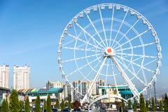 Observation wheel in the center. Sky, city, wheel Stock Photos