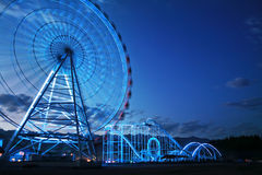 Observation wheel and rollercoaster Stock Photos