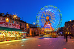 Observation wheel on town square in Alba, Italy. Royalty Free Stock Images