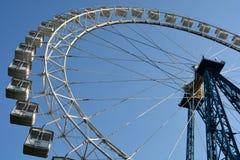 Observation wheel. White observation wheel (ferris wheel) against blue sky Stock Images