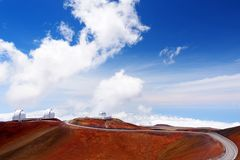 Observatories on top of Mauna Kea mountain peak. Astronomical research facilities and large telescope observatories located at the. Summit of Mauna Kea on the Royalty Free Stock Images