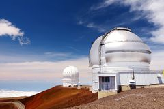 Observatories on top of Mauna Kea mountain peak. Astronomical research facilities and large telescope observatories located at the. Summit of Mauna Kea on the Royalty Free Stock Photo