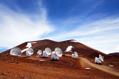 Observatories on top of Mauna Kea mountain peak. Astronomical research facilities and large telescope observatories located at the. Summit of Mauna Kea on the Stock Image