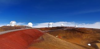 Observatories on top of Mauna Kea mountain peak. Astronomical research facilities and large telescope observatories located at the. Summit of Mauna Kea on the Royalty Free Stock Photos