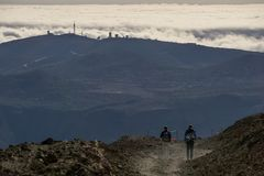 The Observatorio del Teide and two hikers royalty free stock photography