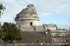 Observatory. Tourists visiting the ruins of the Mayan Astronomy observatory in Chichen Itza, Yucatan stock photography