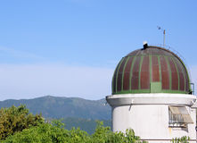 Observatory. A little astronomical observatory close to mountains Stock Image