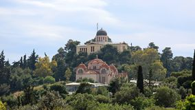 Observatory in Athens. ATHENS, GREECE - MAY 02, 2015: Church Agia Marina and National Observatory on the Hill of Nymphis in Athens, Greece stock images