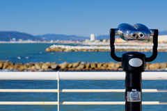 Observatory, coin operated binoculars on the pier in Versilia, vision of the beaches Stock Image