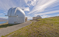 Observatory domes on Mount John Royalty Free Stock Photo