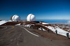 Observatory domes at the peak of Mauna Kea volcano Royalty Free Stock Photography