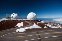 Observatory domes at the peak of Mauna Kea volcano Royalty Free Stock Photo
