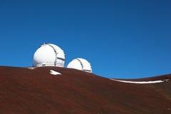 Observatory domes at the peak of Mauna Kea volcano Royalty Free Stock Photos