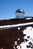 Observatory domes at the peak of Mauna Kea volcano Stock Photos