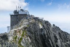 Observatory at Lomnica peak Observatorium na Lomnickom stite, Observatorium Lomnicky stit and tourists walking on viewing platfo stock photo