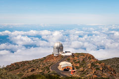 Observatory over the clouds. Observatory sitting on the mountain, over the clouds in the Canary Island of La Palma Stock Photography