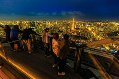 Observatory Roppongi Hills. Tokyo, Japan - April 20, 2017: people take pictures of Tokyo Skyline and Tokyo Tower from atop of Mori Tower in Roppongi Hills royalty free stock image
