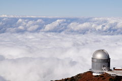 Observatory with a sea of clouds Stock Photos