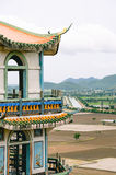 Observatory tower and lonely bird. Observatory Tower of Wat Tham Sua can see land of cornfields and communities of Kanchanaburi royalty free stock image