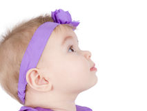 Observe. Pretty little girl is in her headband observing something, perhaps her parents Stock Photo