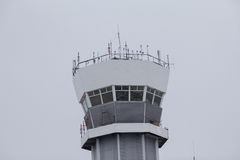 Observe airport tower in cloudy sky Stock Images