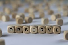 Observe - cube with letters, sign with wooden cubes Royalty Free Stock Photos