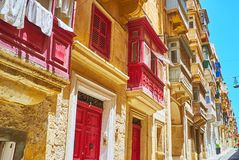 Observe old Maltese balconies, Valletta, Malta. The city walk is the best choice to observe traditional Maltese balconies, decorated with patterns and painted in Royalty Free Stock Image
