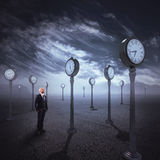Observe the passage of time. Man in  place with antique watches Stock Photo