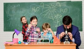 Observe reaction. Science is always the solution. School chemistry experiment. Explaining chemistry to kids. Fascinating. Chemistry lesson. Man bearded teacher royalty free stock images