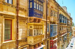 Maltese balconies of Valletta, Malta. Observe traditional wooden Maltese balconies, typical for historical stone edifices in Valletta, Malta Royalty Free Stock Images