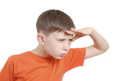 Observer. Boy with a serious look on one's face royalty free stock images