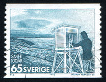 Observer Reading Temperature. SWEDEN - CIRCA 1973: stamp printed by Sweden, shows Observer Reading Temperature, circa 1973 Stock Images