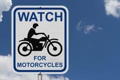 Observez pour le panneau d'avertissement de motos Photographie stock libre de droits