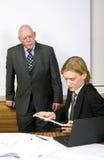 Observing an associate Stock Photo