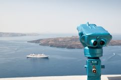 Observing binoculars in Santorini, Greece Royalty Free Stock Photo