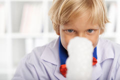 Observing chemical reaction Royalty Free Stock Photos