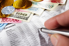 Observing Foreign Exchange Sheet Stock Photo