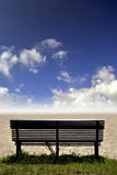 Bench, grass and sky Royalty Free Stock Photo
