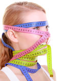 Obsessed fitness woman with colorful measure tapes Royalty Free Stock Photos