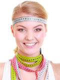Obsessed fitness woman with a lot of colorful measure tapes Stock Photography