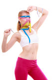 Obsessed fitness woman with a lot of colorful measure tapes Royalty Free Stock Photography