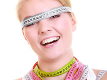 Obsessed fitness woman with a lot of colorful measure tapes Stock Images