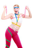 Obsessed fitness woman with a lot of colorful measure tapes Stock Photos