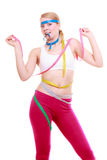 Obsessed fitness woman with a lot of colorful measure tapes Royalty Free Stock Images