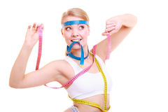 Obsessed fitness woman with a lot of colorful measure tapes Stock Photo