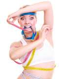Obsessed fitness woman with a lot of colorful measure tapes Royalty Free Stock Photos