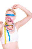 Obsessed fitness woman with a lot of colorful measure tapes Stock Image