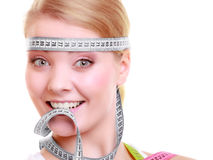 Obsessed girl with gray measure tapes around her head Stock Photography